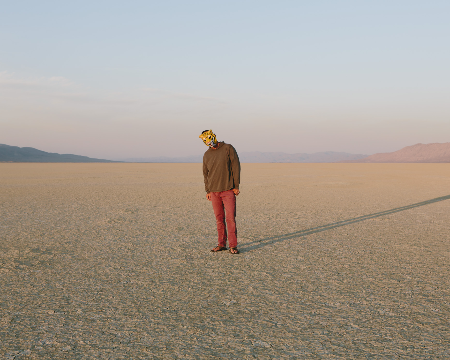 Man wearing mask, standing on playa, Black Rock Desert, Nevada - Paul Edmondson