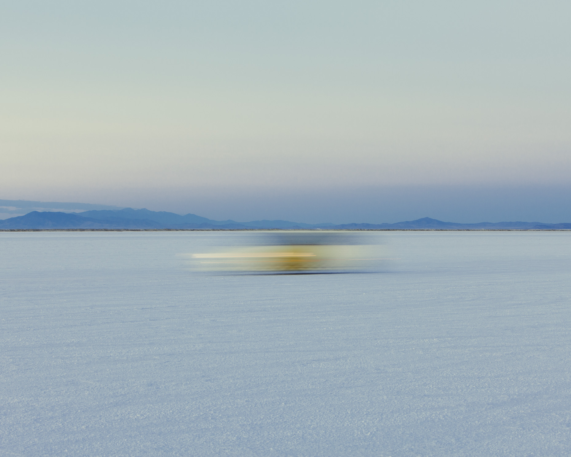 Moving car on Bonneville Salt Flats, Speed Week, Utah - Paul Edmondson
